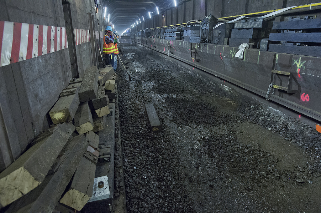 Workers replace track on the L line in April 2015. Photo by Patrick Cashin via the MTA Flickr