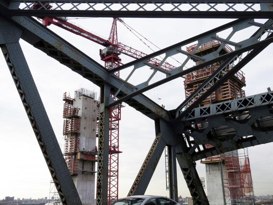 Pillars of the new span have risen above the original bridge