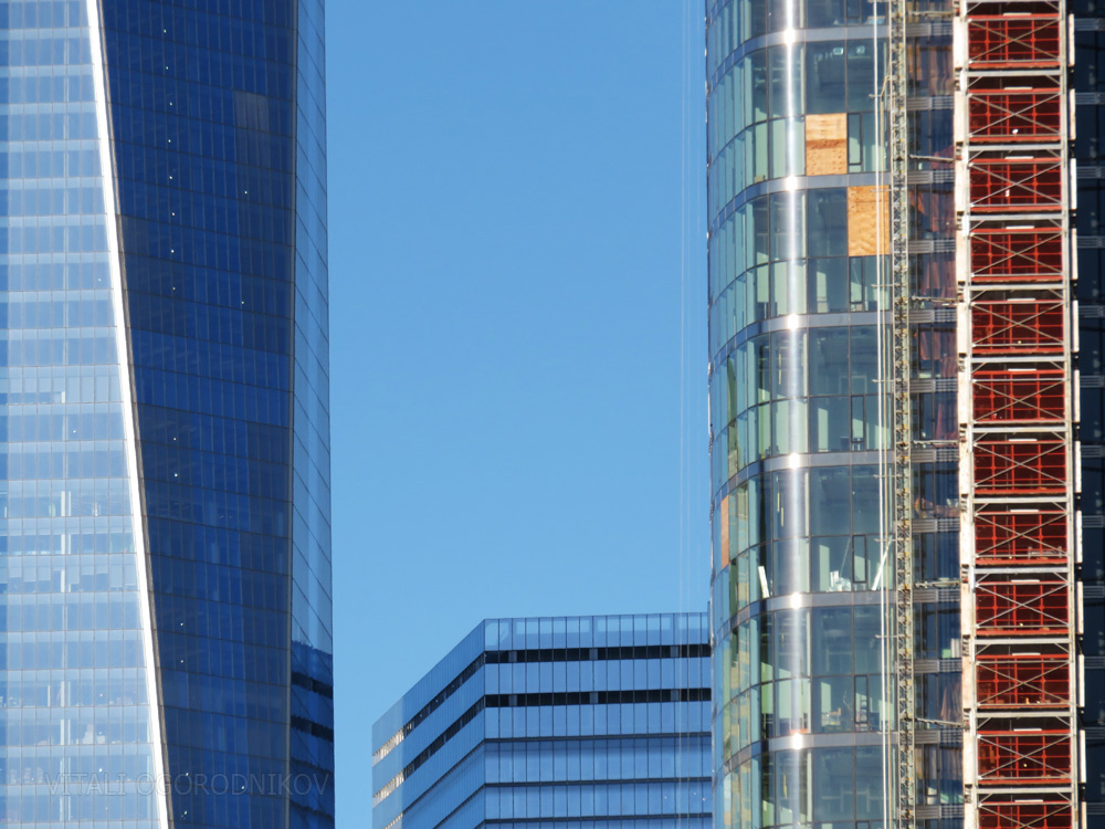 (from left to right) Facades of One World Trade Center, Seven World Trade Center, and 50 West Street