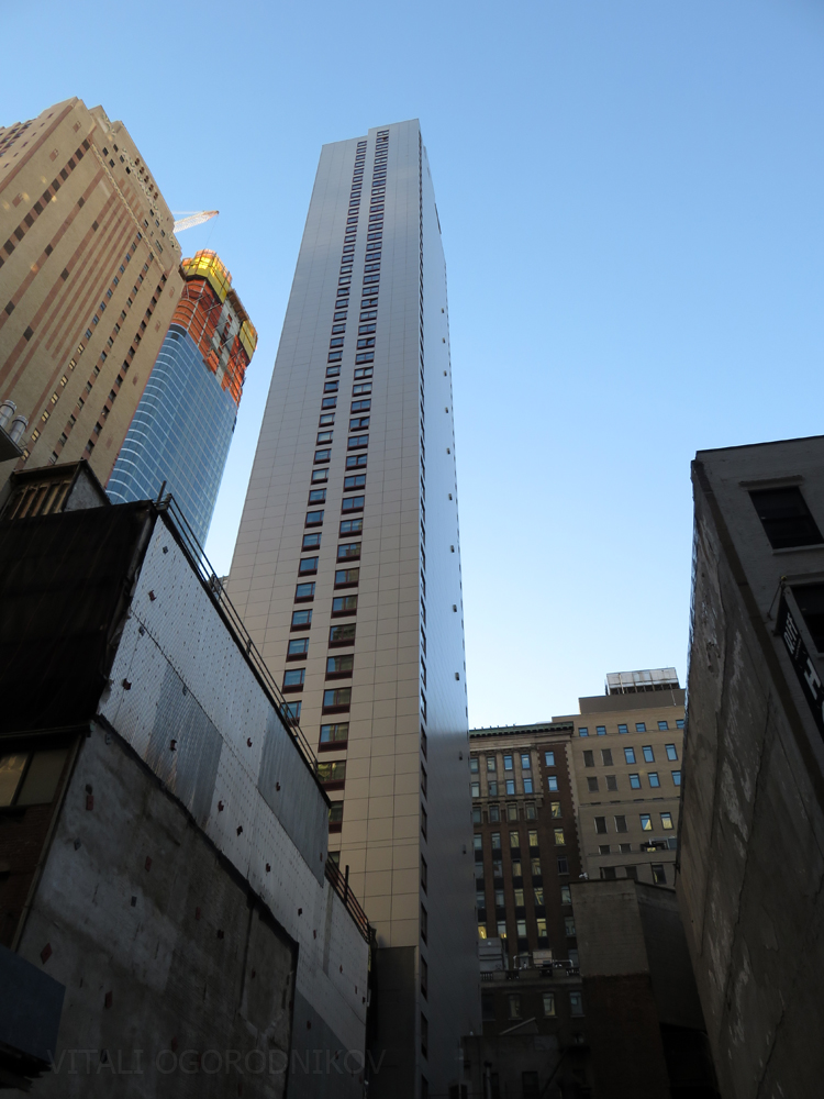 Background, from left to center: 19 Rector Street, 50 West Street (under construction), and Holiday Inn at 99 Washington Street