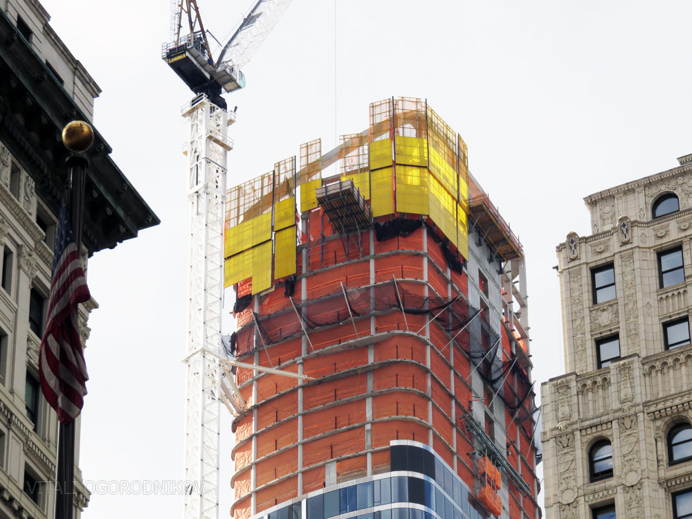 50 West Street is topped out; looking west from Wall Street and Broadway