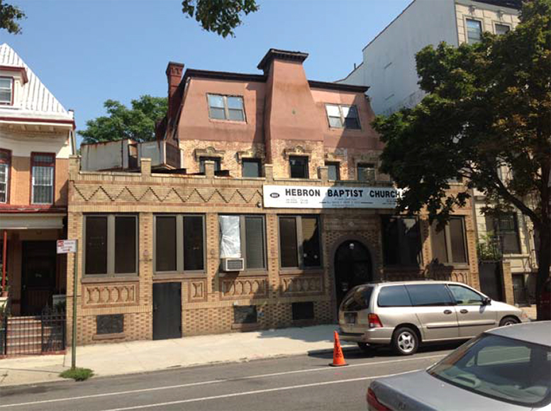 599 Willoughby Avenue with Hebron Baptist Church signage. Photo via Massey Knakal Realty Services.