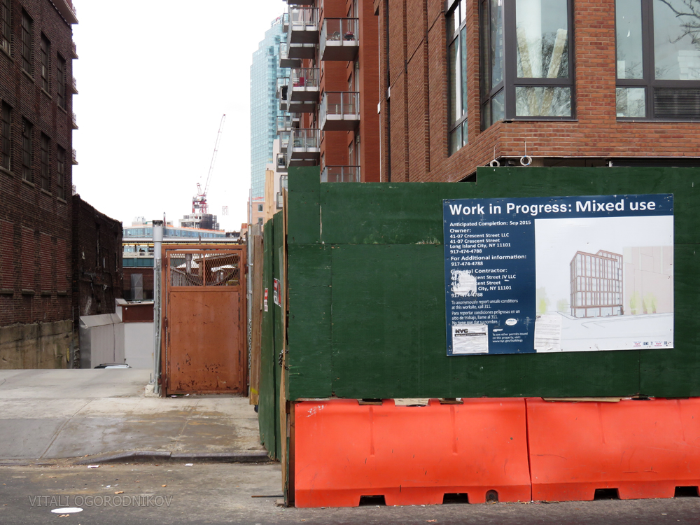 Signage on 41st Avenue, with 43-25 Hunter Street construction visible in the distance