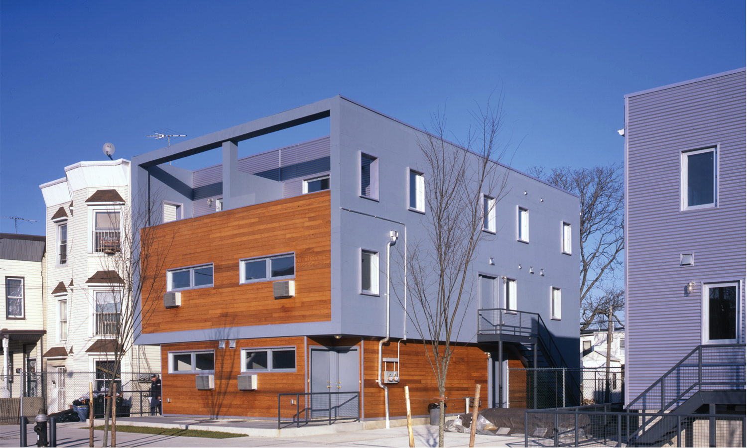 Homes at Glenmore Gardens in East New York, built in 2007 through Bloomberg's New Foundations program. photo via LTL Architects