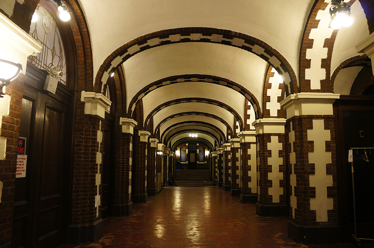 An arched hallway at the Bedford Union Armory