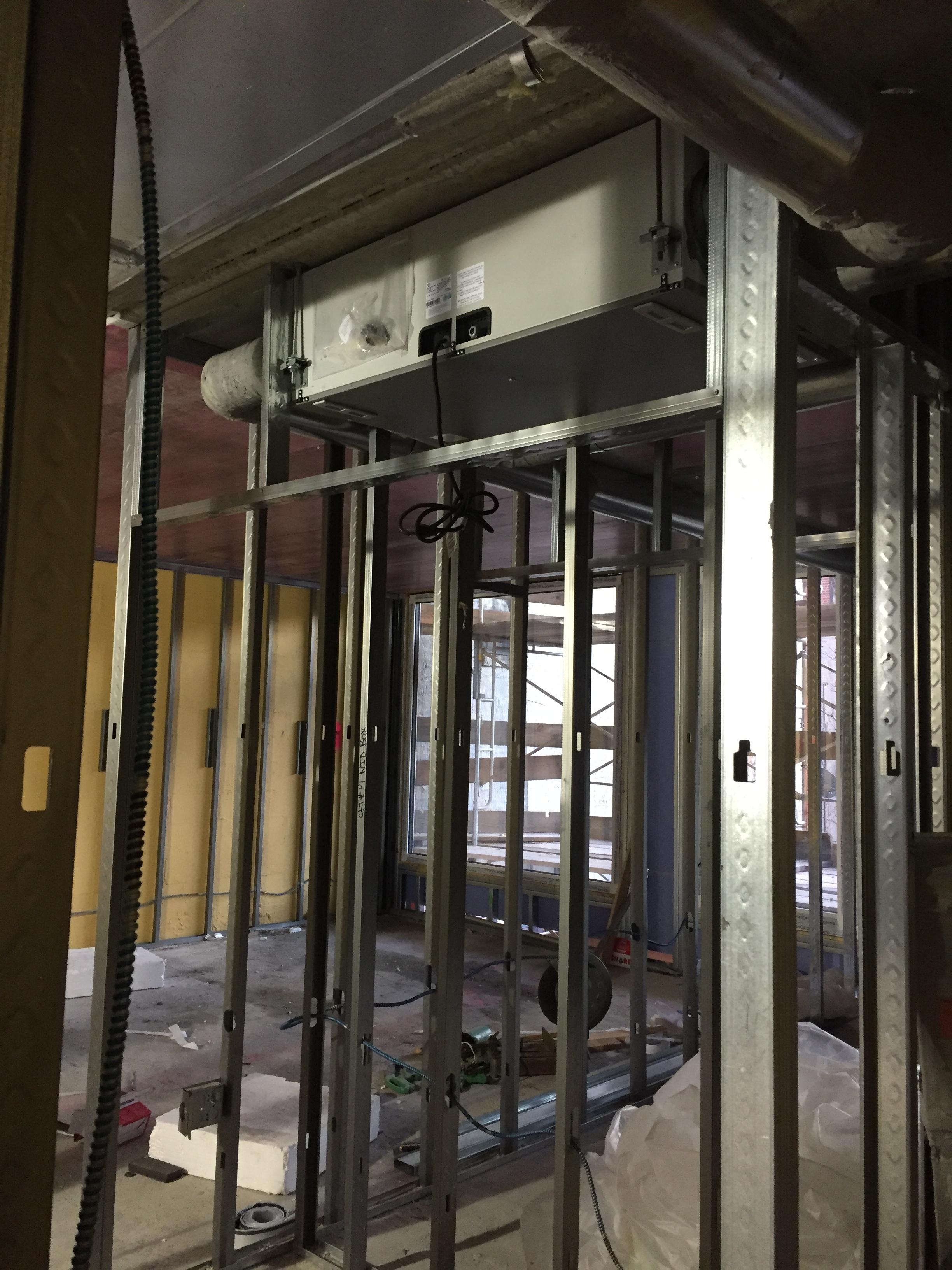 An ERV unit being installed at 542 West 153rd Street