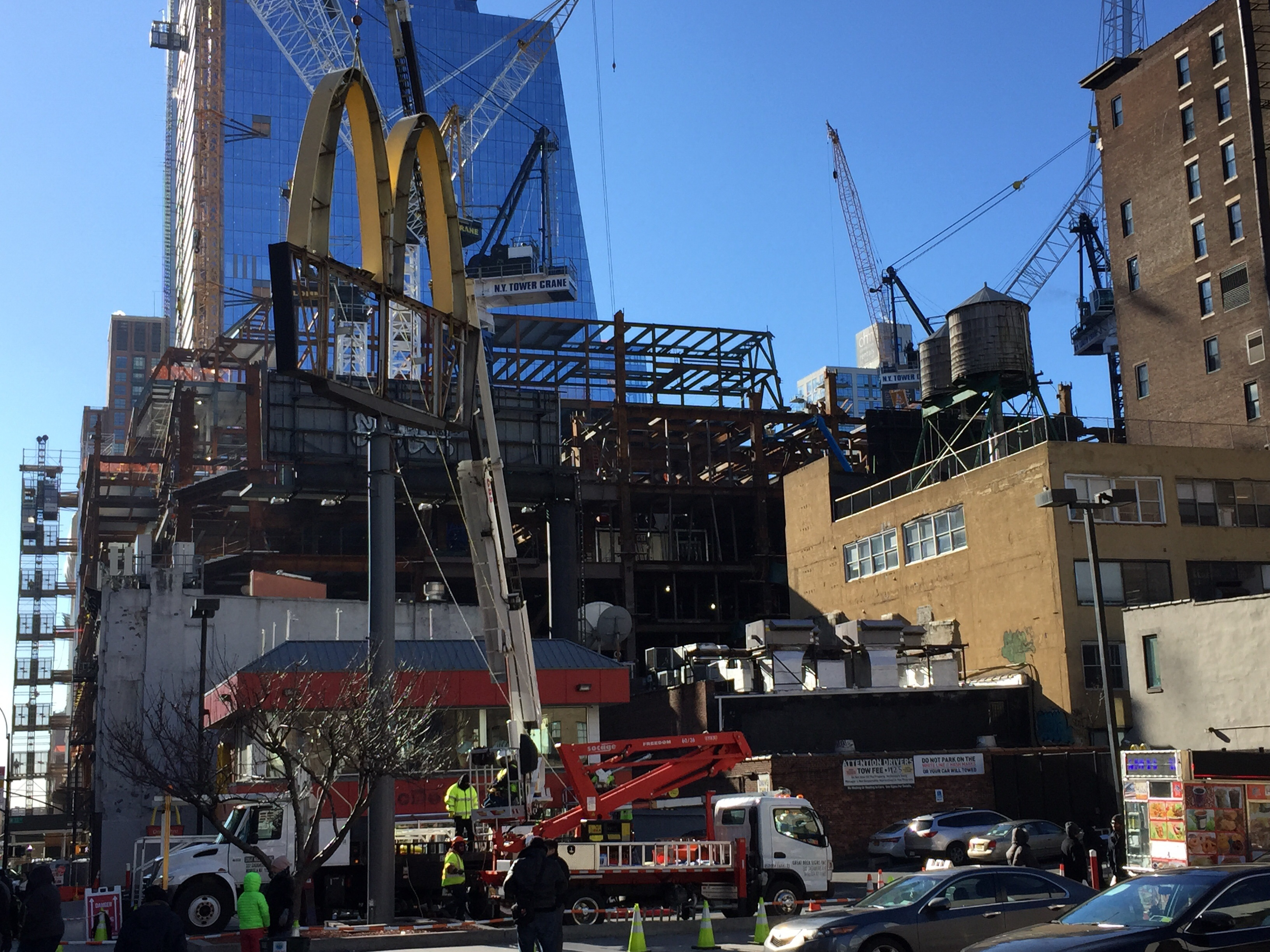 Demolition of the McDonald's at 427 Tenth Avenue, with 10 Hudson Yards in the distance. Photo by YIMBY user Robert Walpole.