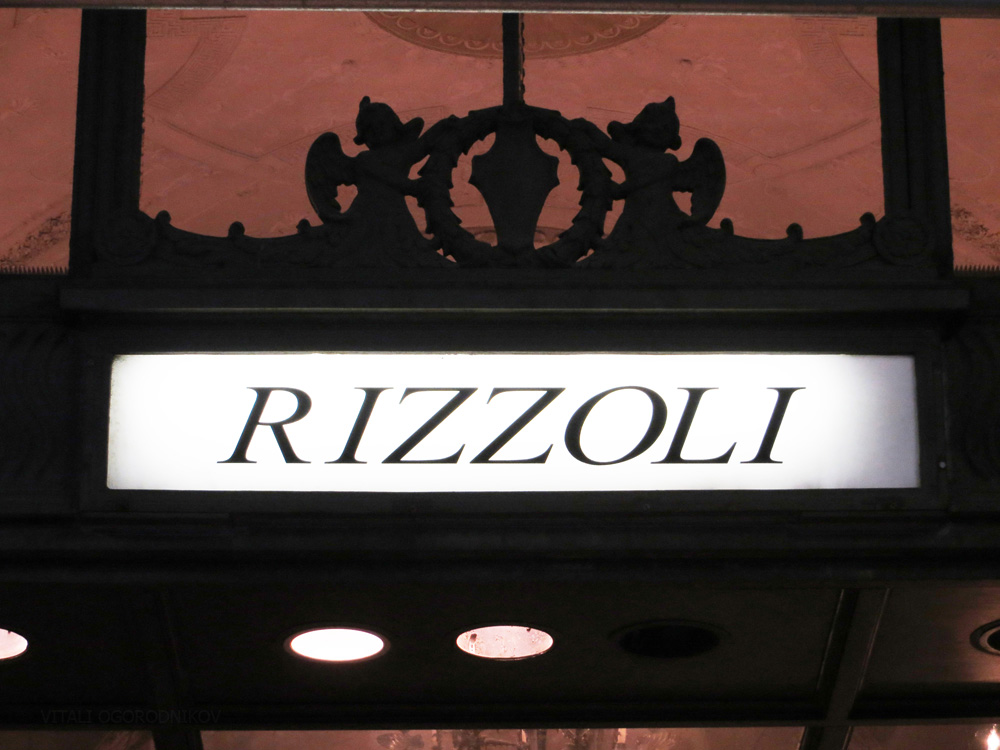 IMG_4993-rizzoli-w-57th-sign-small-wmark