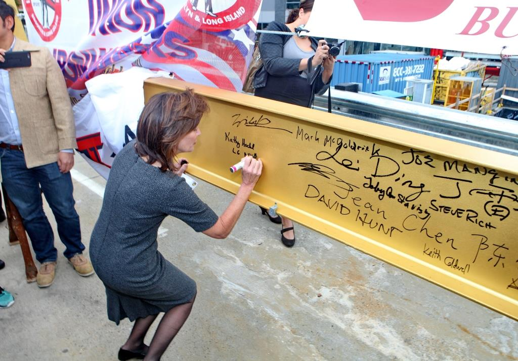 New York Lt. Gov. Kathy Hochul signs the topping out beam for Phase I of Flushing Commons. Credit: F&T Group