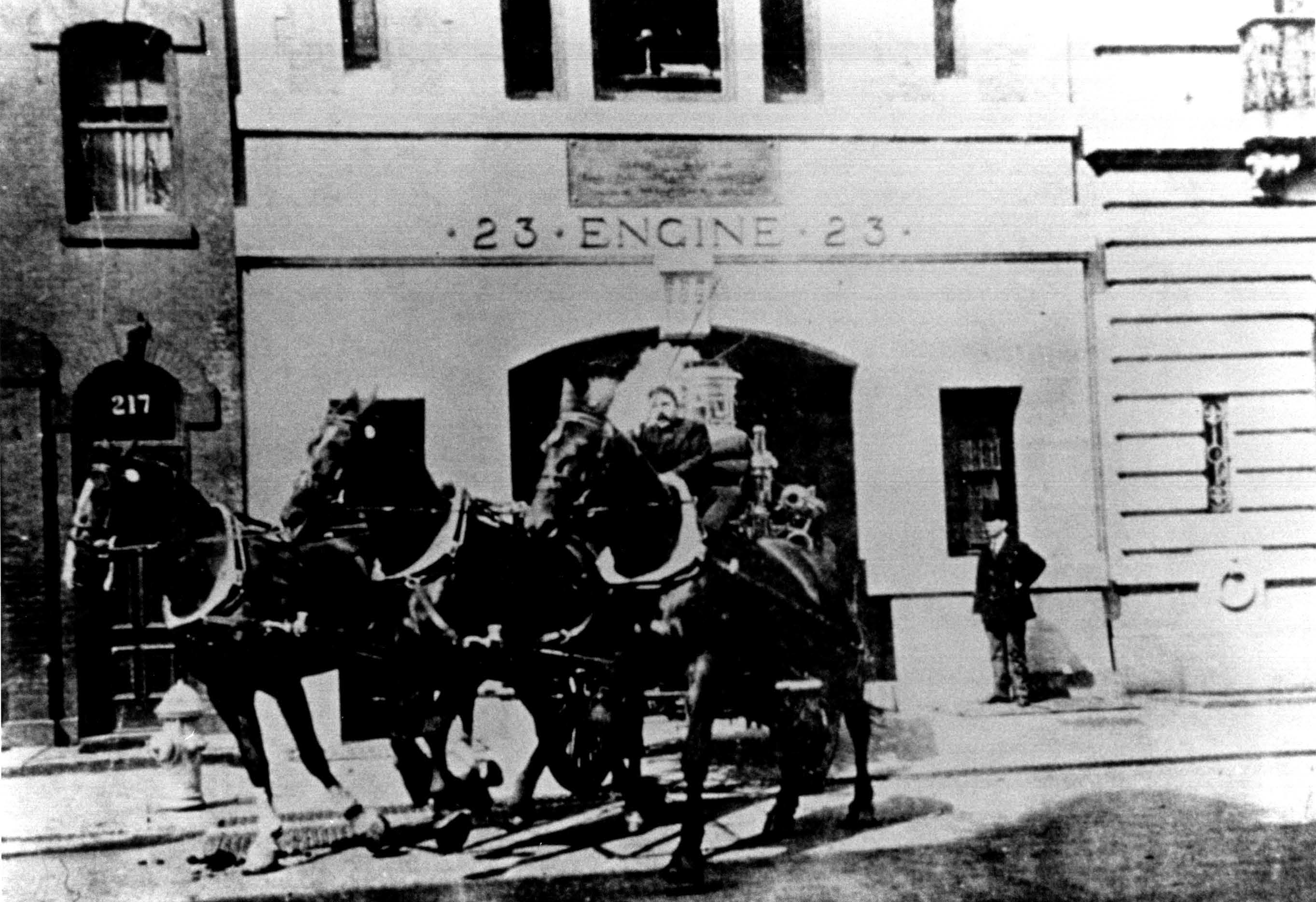Horse-drawn fire-fighting apparatus at Engine Company No. 23 in 1907. Photo via LPC.