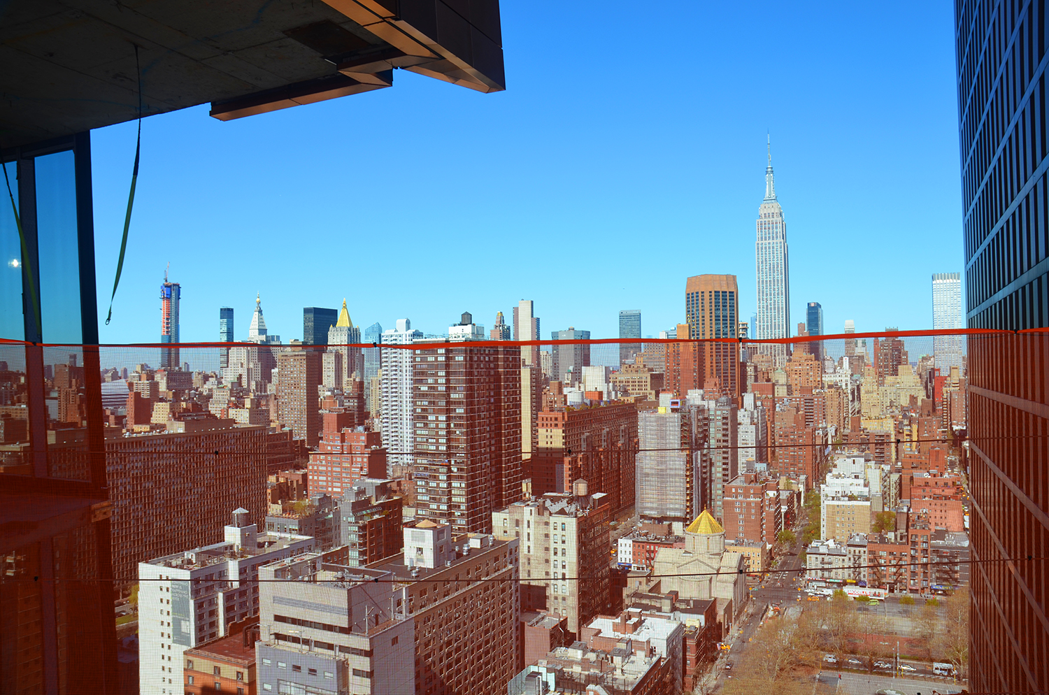 View of the Empire State Building and Midtown from the skybridge at the American Copper Buildings
