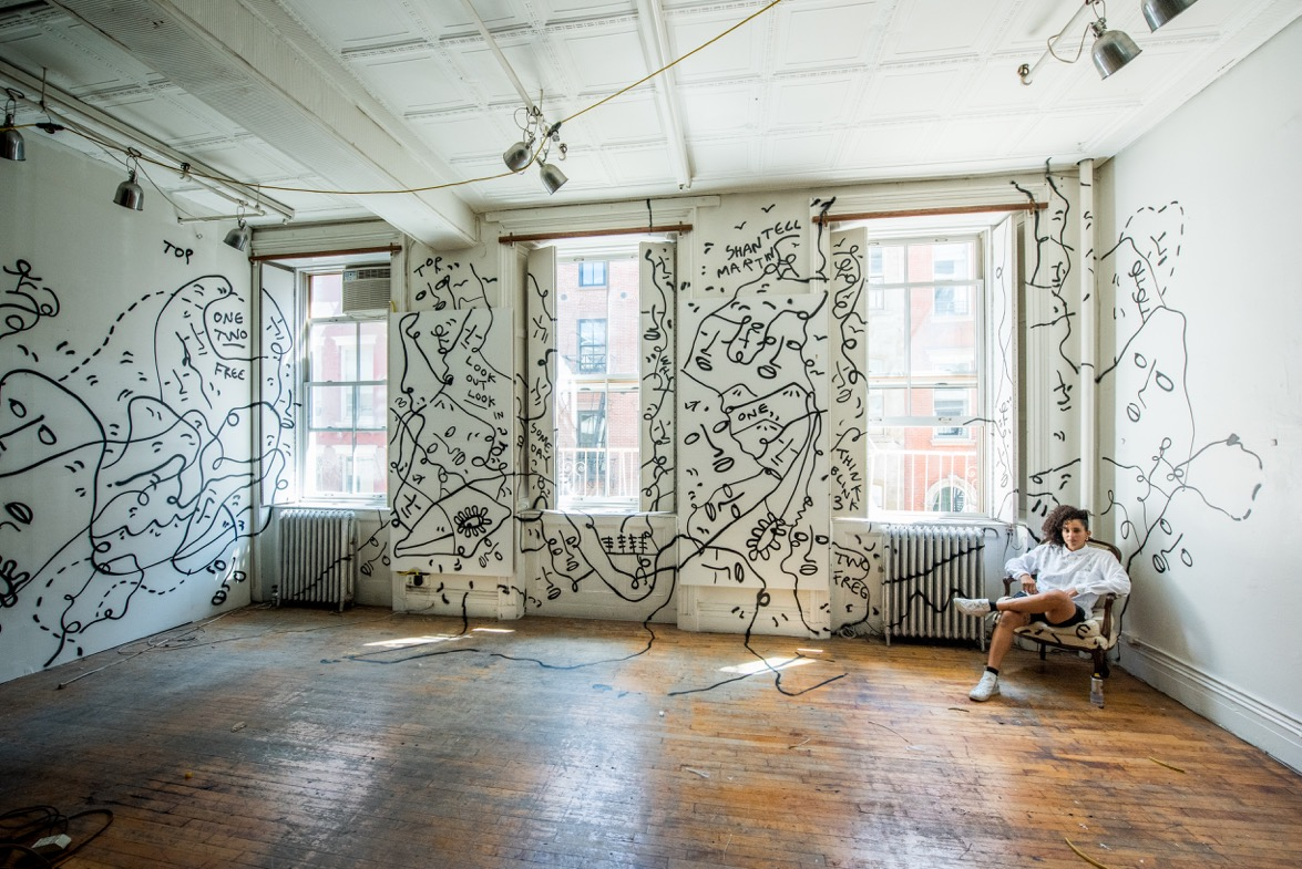 Shantell Martin sits amongst her work at 25 Mercer. Credit: Roy Rochlin