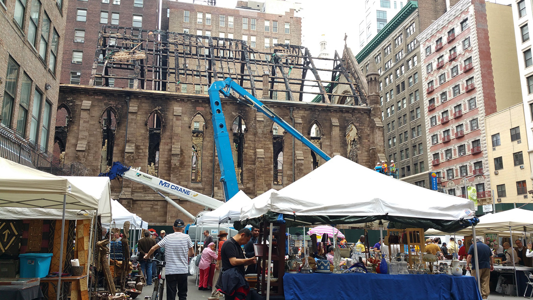 The cathedral on May 14, with the roof beams still in place. The Chelsea Flea Market is in the foreground.