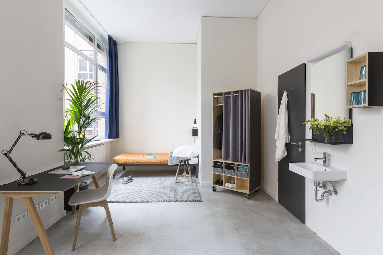 Photo of a model dorm bedroom via Macro Sea