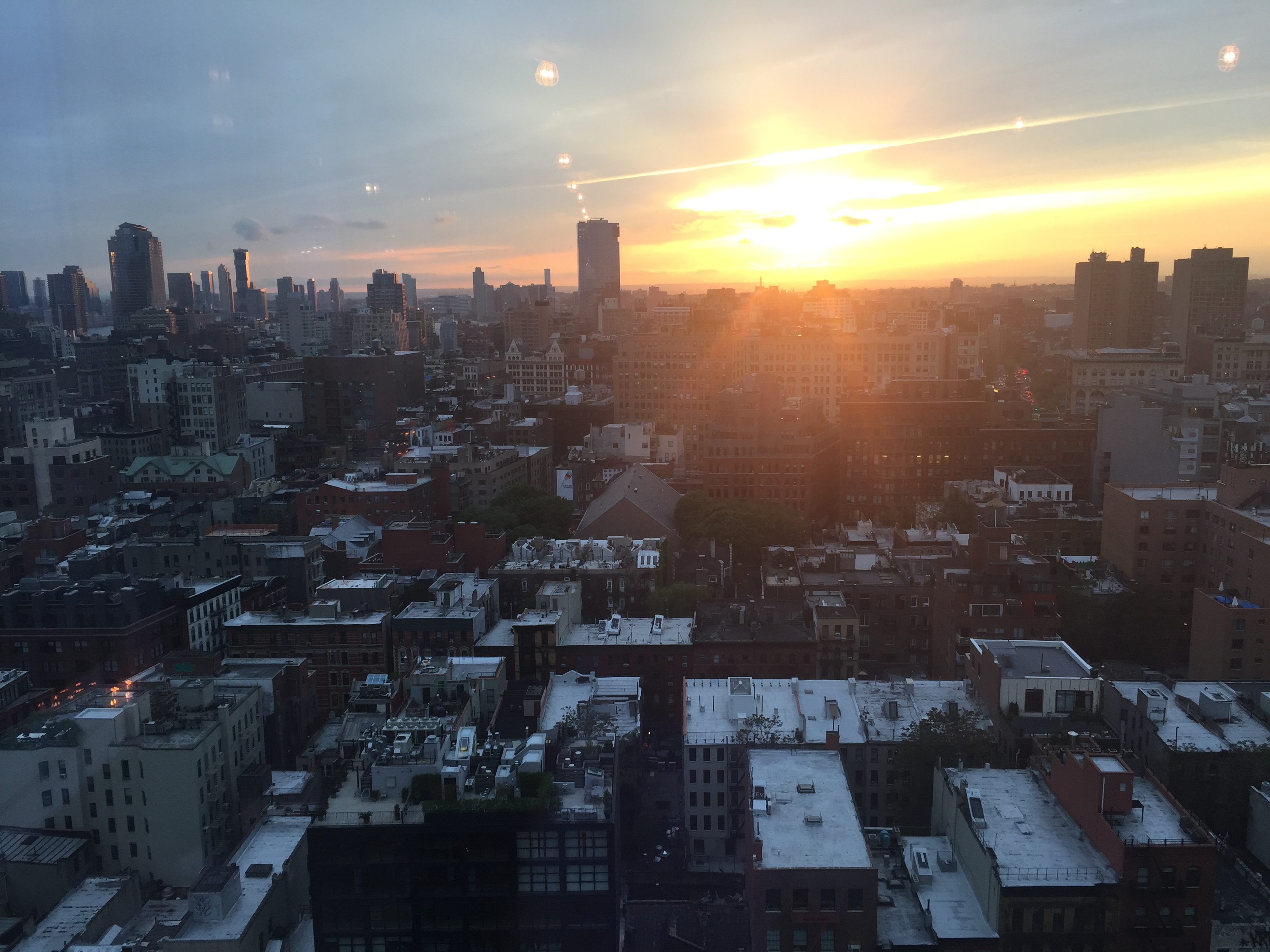 Sunset, seen from 215 Chrystie. Notice the shine on the URL Harborside tower in Jersey City. Photo by Evan Bindelglass, taken on iPhone 6