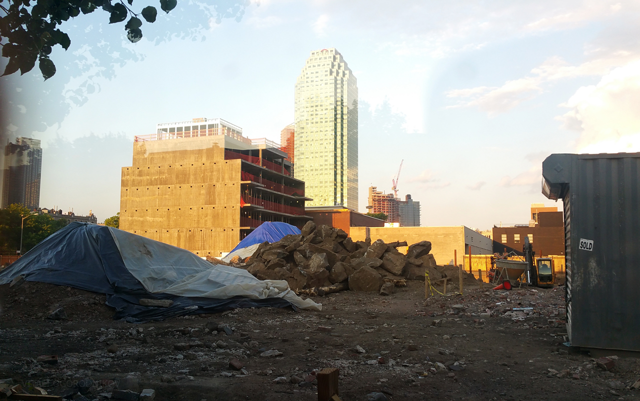 Looking east across the construction site for 11-15 46th Avenue, with the Court Square skyline rising in the background.
