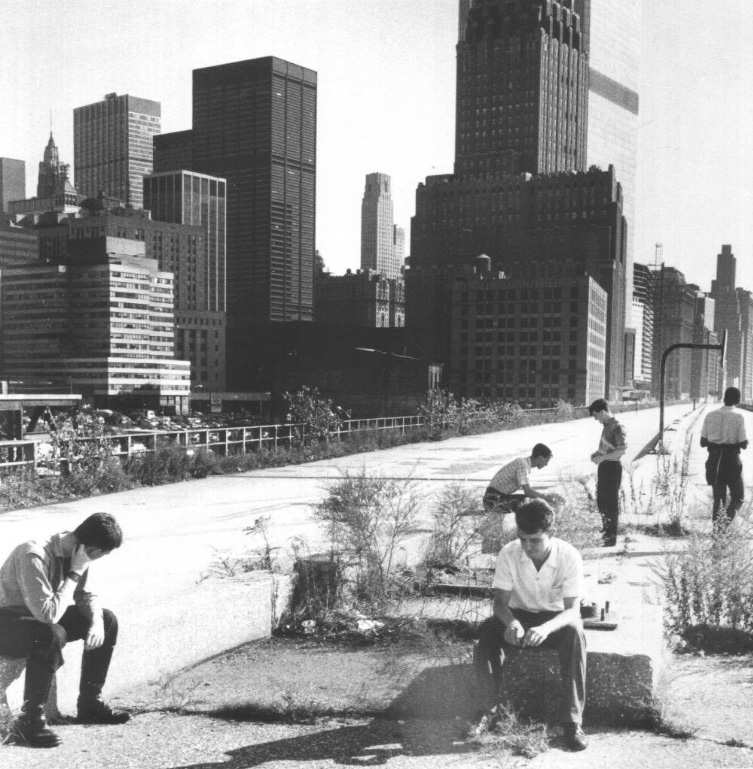 Members of the post-punk band A Certain Ratio atop the abandoned expressway. Circa 1980-1981. In a couple of years, the viaduct would be gone and 101 Murray would stand at the center of the photo. Unknown photographer