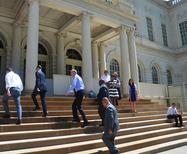 Mayor Bill de Blasio ascends the City Hall steps on Monday, June 6, 2016