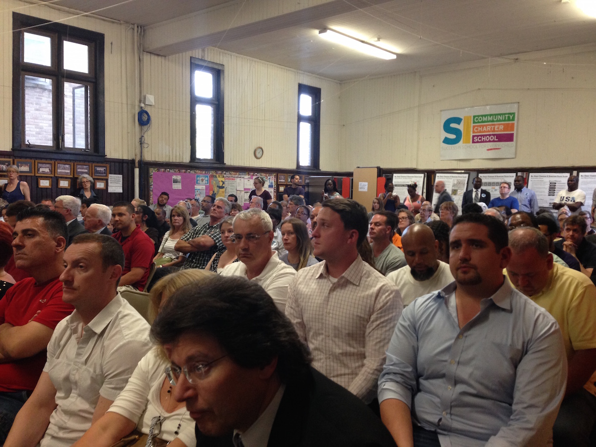 A packed house listens during DCP's meeting on the Bay Street corridor rezoning.