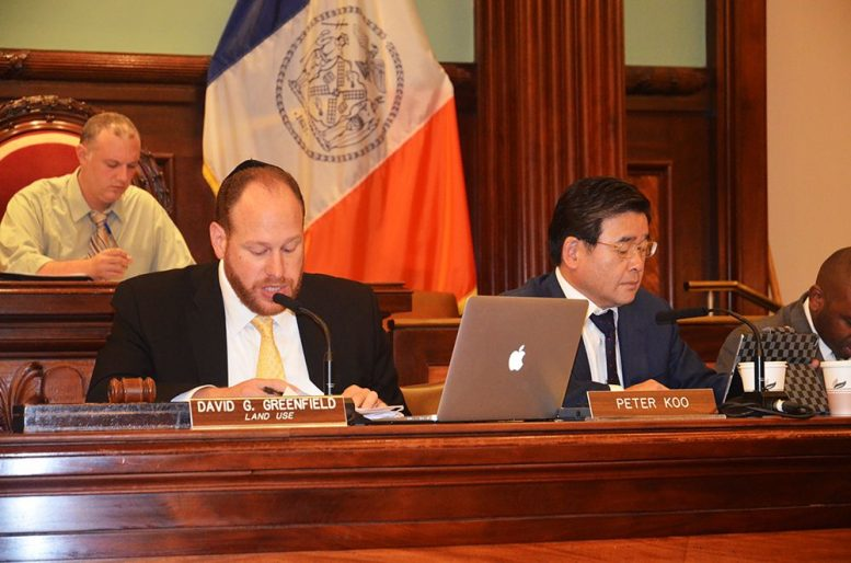 Council members David Greenfield and Peter Koo lead a public hearing on Intro 775 last September.