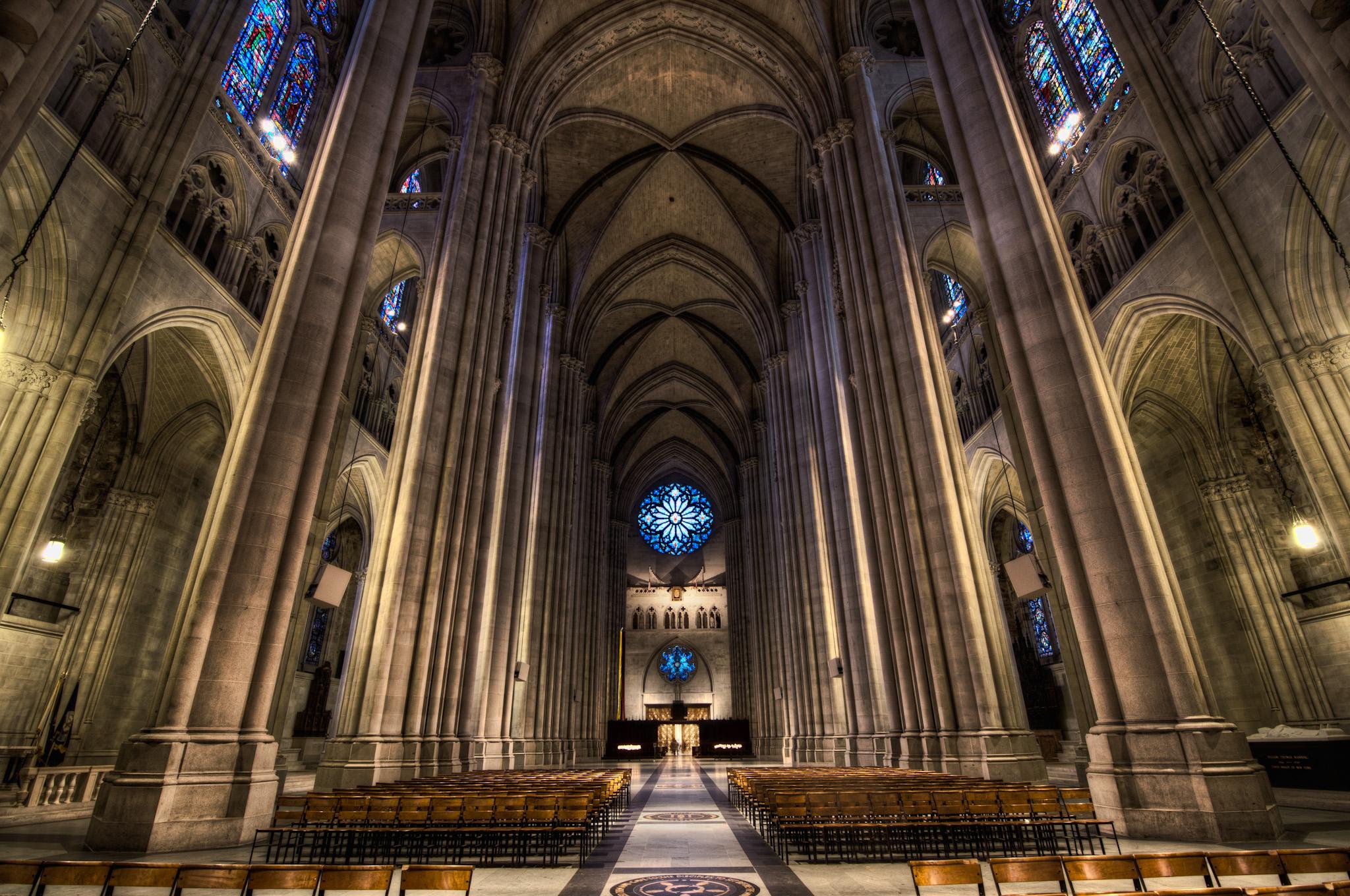"""Cathedral Church of St. John the Divine, 2011. Credit: <a href=""""https://www.flickr.com/photos/litetra/5883079317/in/photolist-9XSjw2-9Ywxdy-4hv9nj-a6QKP-qWBCnF-9qhy3q-8LXWxc-w8d14-8EuSWY-qWtWtu-bWX5aK-9Agyw7-mJ1W1h-89vvnv-8TD48T-8ErKRM-8uAHwd-GL3trk-ouTKbs-cjET5-qWsLUE-8EwFDC-9DgJjB-8EwBbf-97jb5b-afg5R-9qeydg-8ErNiH-re3EZr-8EttVR-pYoqnf-qWzSm8-8Ewkef-pFV7Ph-9Agz4Y-8TGa8s-89vzTZ-8Ewich-pFTnT6-9qhHdL-aF89Gb-rdX3ab-qWzNbK-pW9ZP9-cW5vau-9KDEf2-p2t2Uw-aF86zf-8EwsmJ-aF4iAr"""">Bobby Bradley/Flickr</a>"""