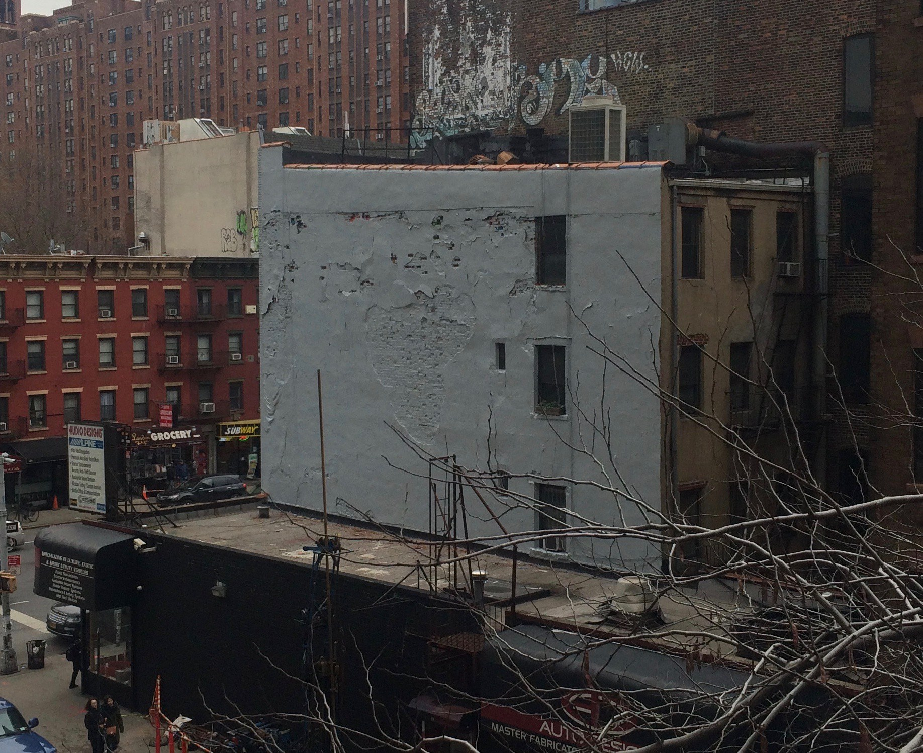 The buffed wall where the Eduardo Kobra mural used to be at 253 10th Avenue. photo by Mary Lane/NYC Cliche