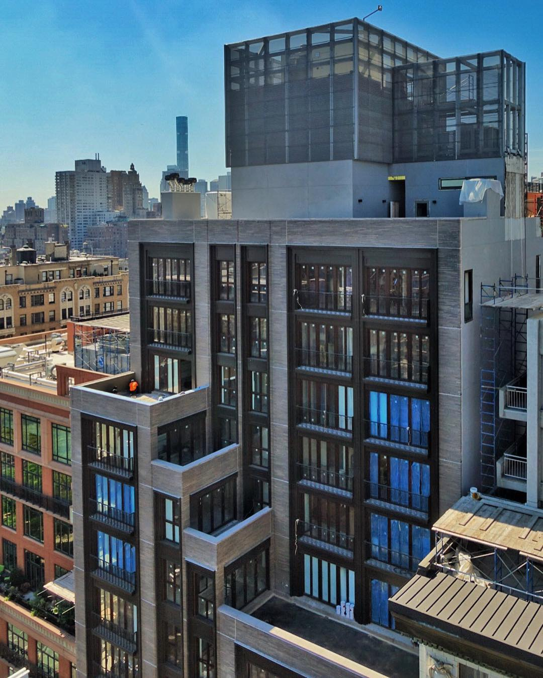 210 West 77th Street as seen from 221 West 77th Street. Photo by David Palmieri via Vertical_Gotham on YIMBY Forums