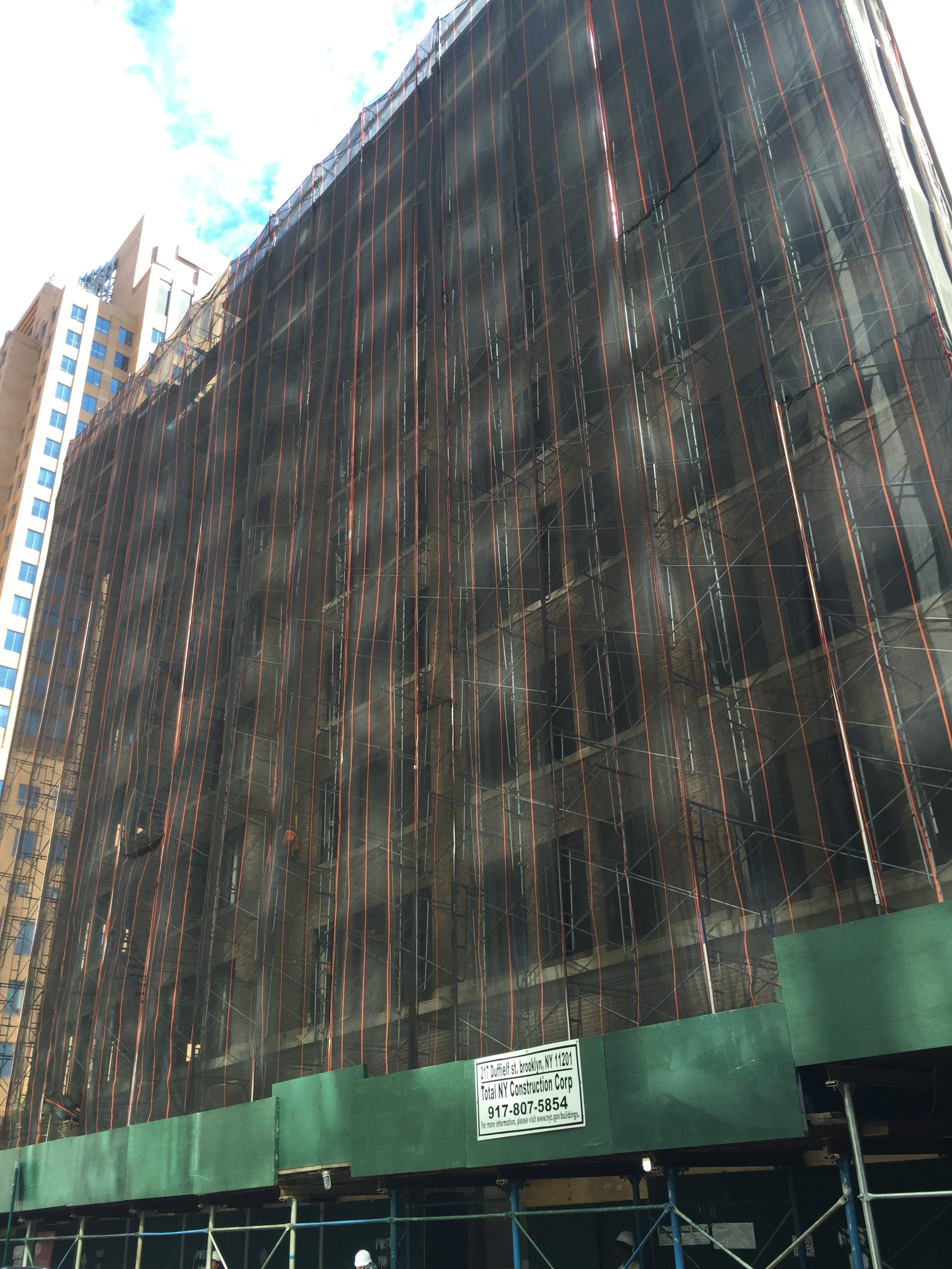 217 Duffield Street shrouded in scaffolding, photo by Tectonic