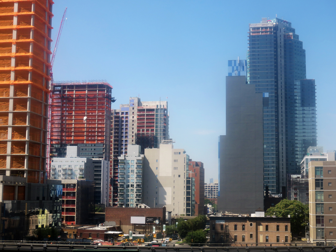 Looking southwest from Queens Plaza. Under-construction projects: 28-10 Jackson Avenue (far left), Eagle Lofts (bottom left), 44-26 Purves Street (left), The Edison at 29-21 44th Drive (center left), Watermark Court Square at 27-19 44th Drive (center), Aloft Long Island City (center right), The Hayden at 43-25 Hunter Street (right), and Hyatt Place (bottom right).