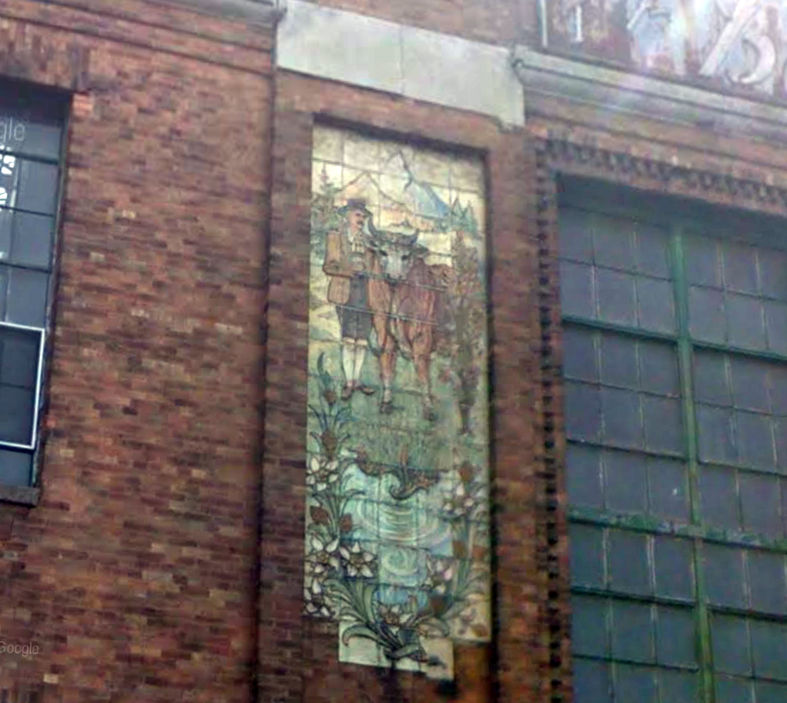 Close-up of one of the mosaics at the former Empire State Dairy Company complex in East New York, September 2015. Via Google Maps