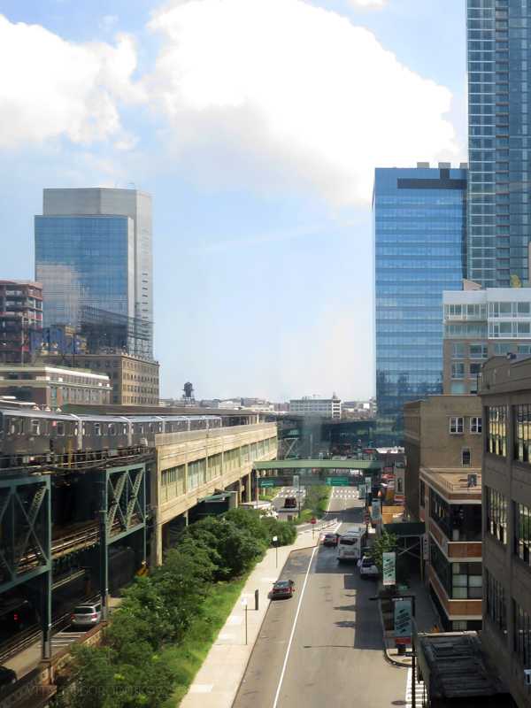 Looking east along Queens Plaza South. 24-16 Queens Plaza South, visible in the center, would rise about as high as Two Gotham Center in the center background. August 2016.