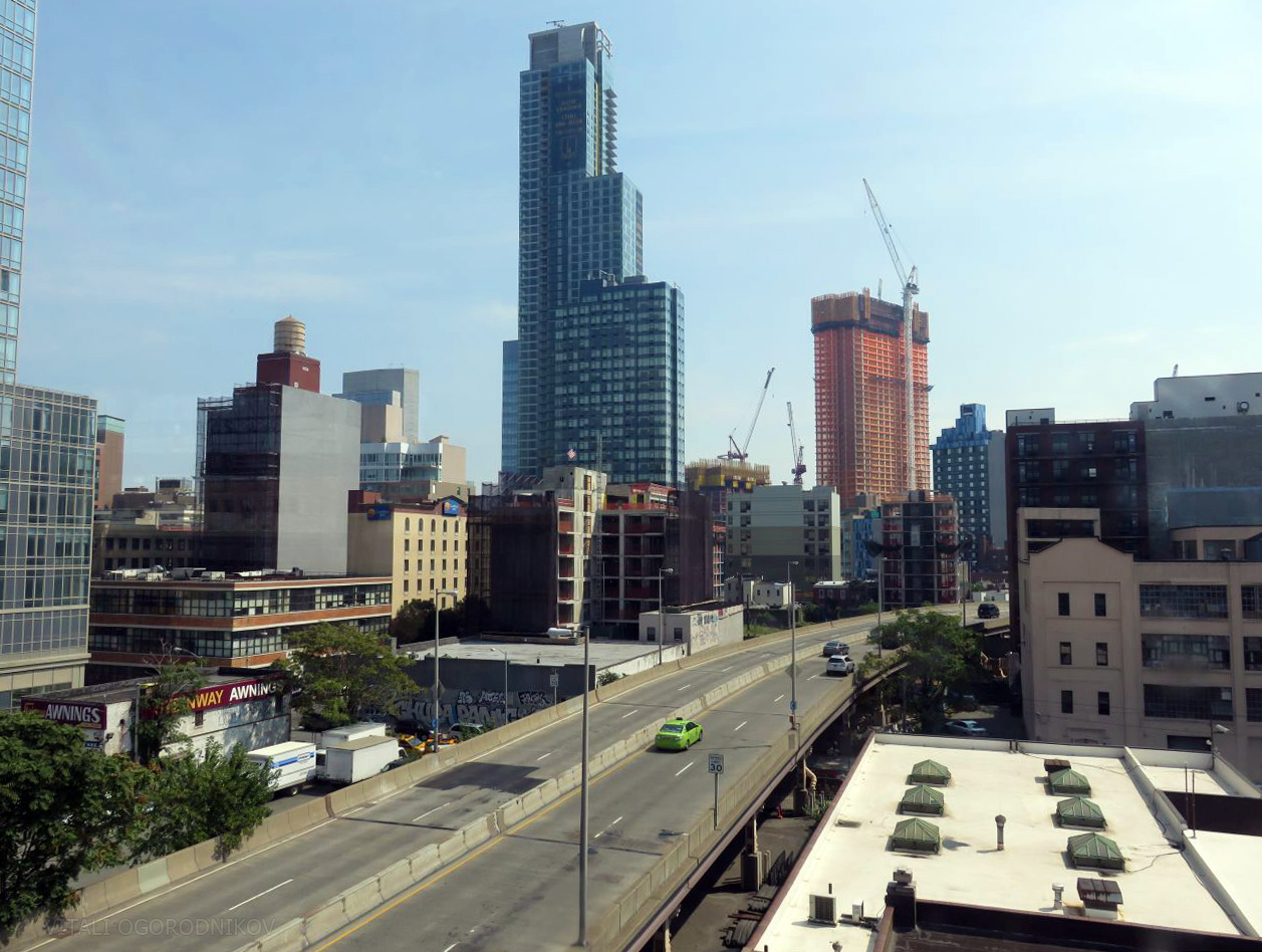 Looking southeast, with the Queensboro Bridge viaduct on the foreground. Tower 28 is in the center. September 2016.