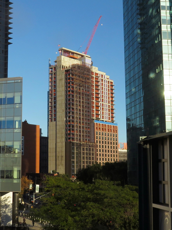 Watermark Court Square (left) and the Harrison (right), with 44-26 Purves Street behind. Each building is marked by a topping-out flag.