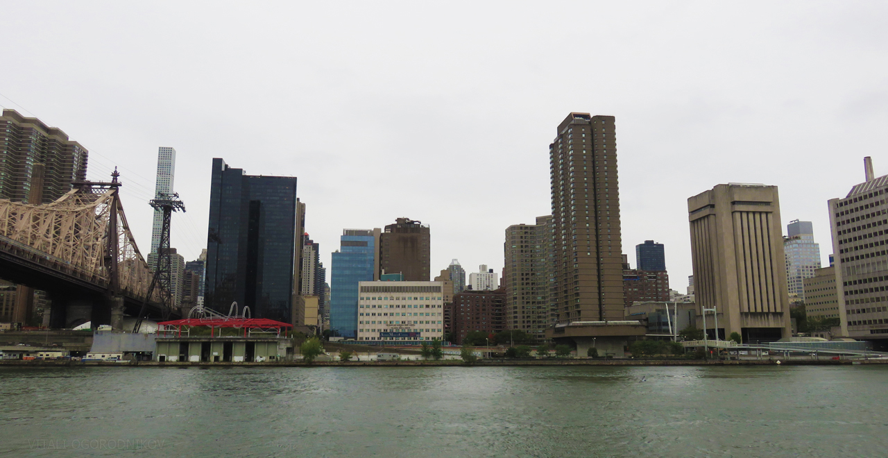 Queensboro Bridge is on the left. The Scholars Building is in the center right. Looking west.