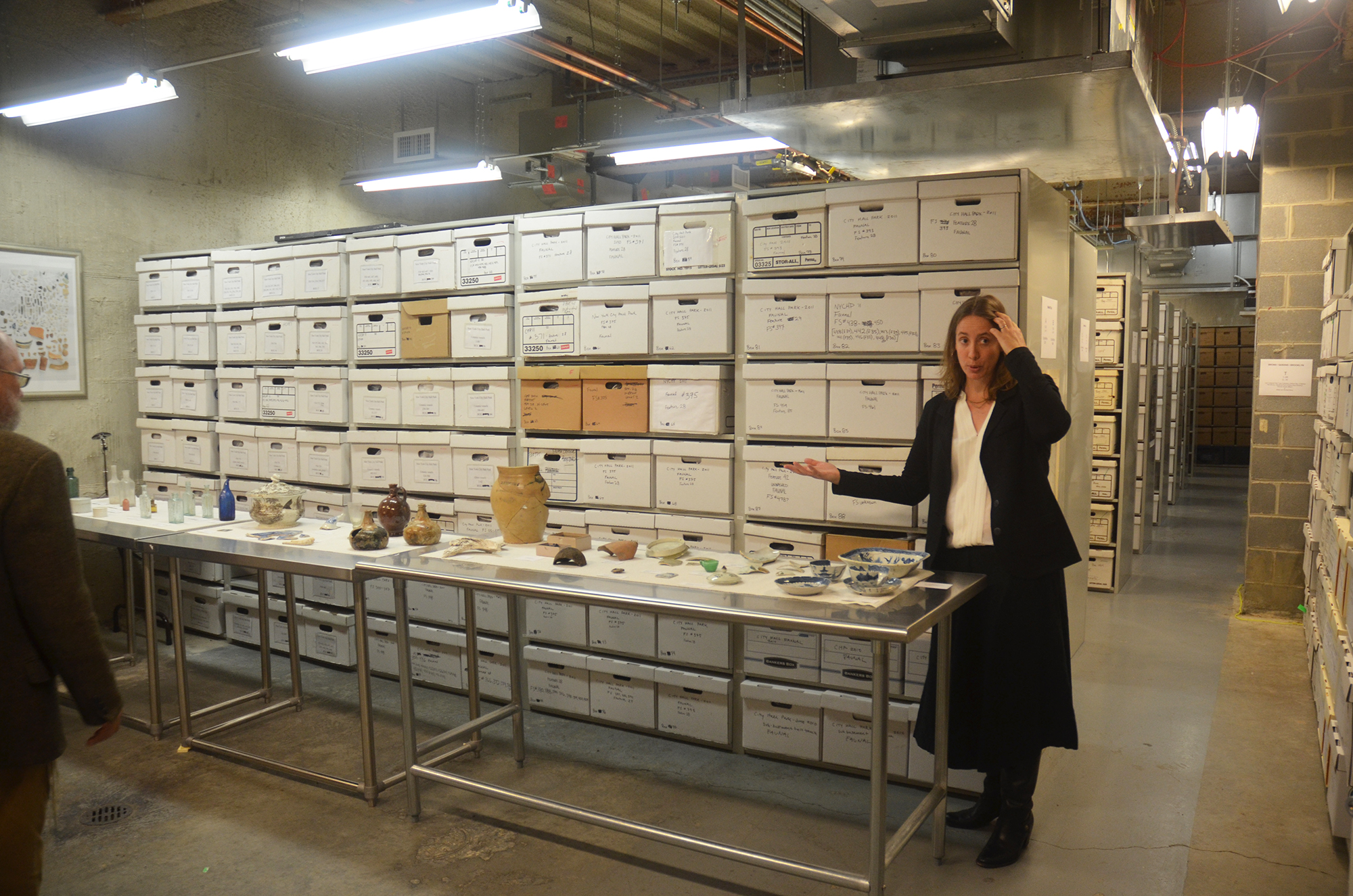 Jessica MacLean, urban archaeologist for the Landmarks Preservation Commission, welcomes people to the NYC Archaeological Repository Nan A. Rotshschild Research Center. All photos by the author unless noted