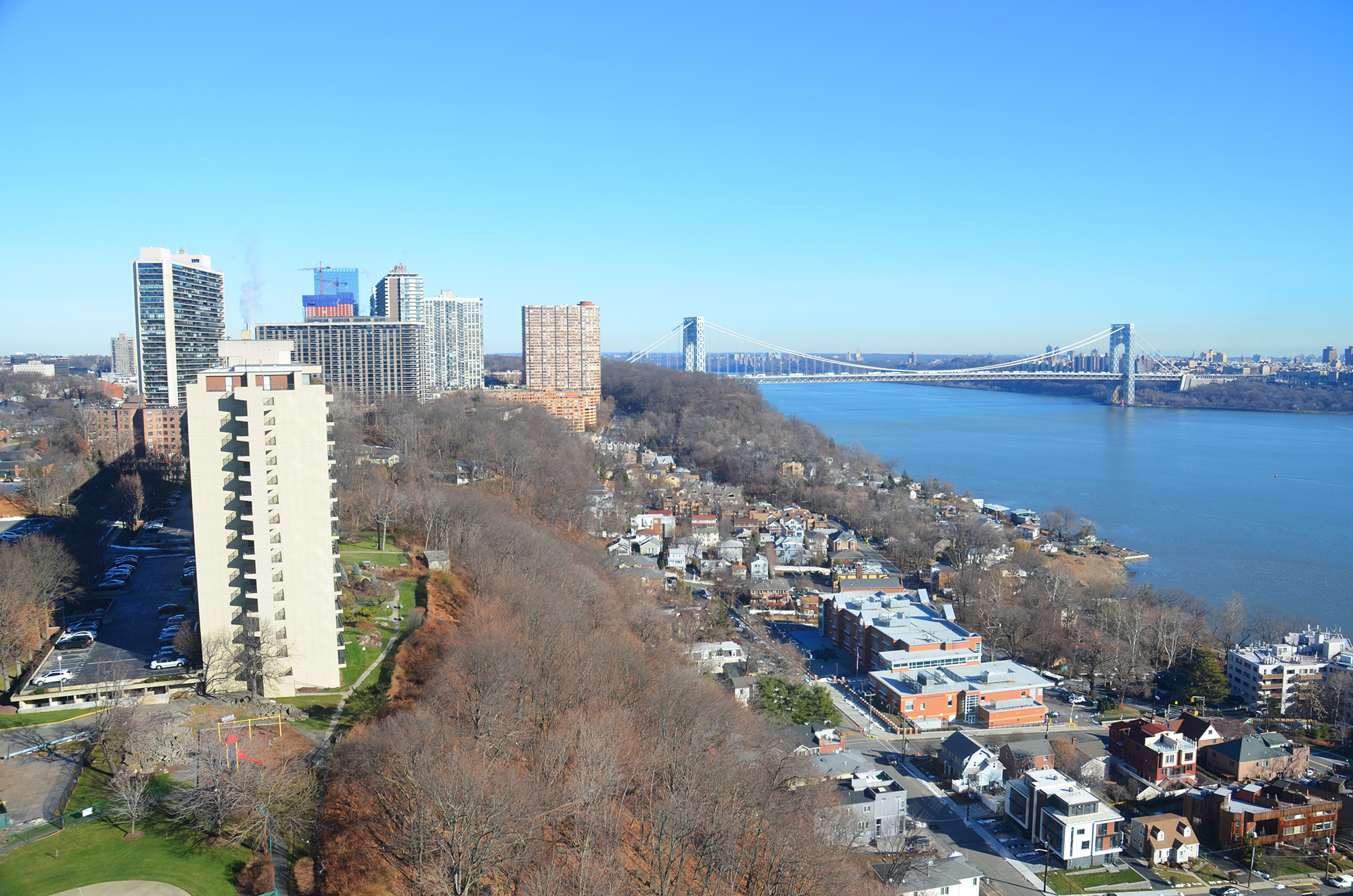 Fort Lee, with The Modern II rising, and the George Washington Bridge as seen on December 20, 2016