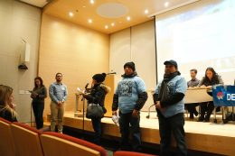 Activists from the Movement for Justice in El Barrio speak at last Thursday's public meeting on the East Harlem rezoning. photo by Rebecca Baird-Remba