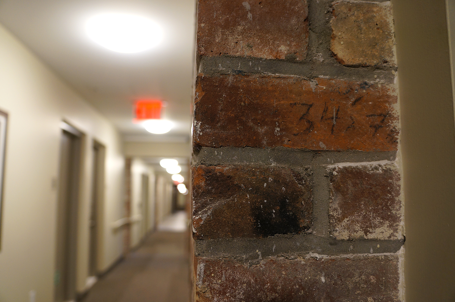 An exposed piece of the brick party wall that used to separate tenements before the renovation. photo by Rebecca Baird-Remba