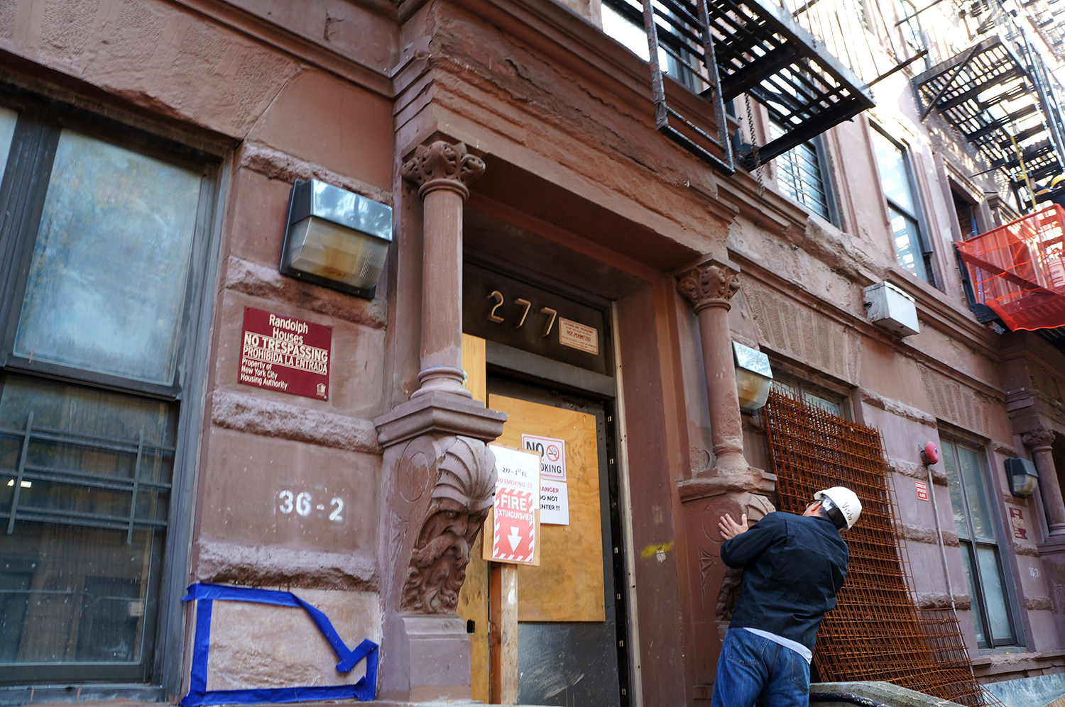 A historian examines facade details at Randolph Houses. photo by Rebecca Baird-Remba
