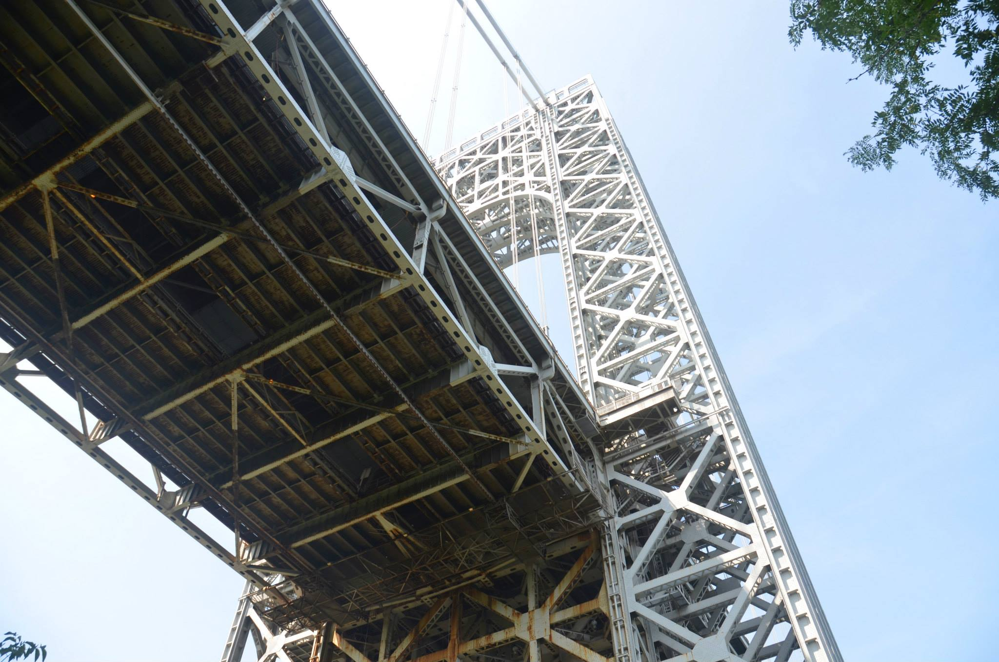 "The George Washington Bridge's New York tower, with a ""traveler"" on the underside of the roadway. Photo by Evan Bindelglass."