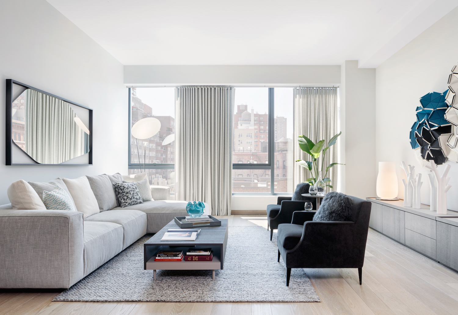 The living room in a seventh floor model unit at 90 Lexington Avenue. photo via HFZ Capital