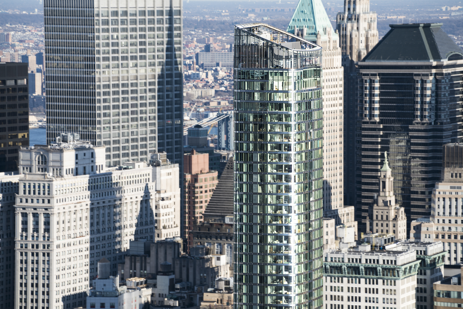 """A northeast facing view of 50 West Street, with the Woolworth Building and the Manhattan Bridge in the background. photo by <a href=""""http://www.quallsbenson.com/"""">quallsbenson</a>"""
