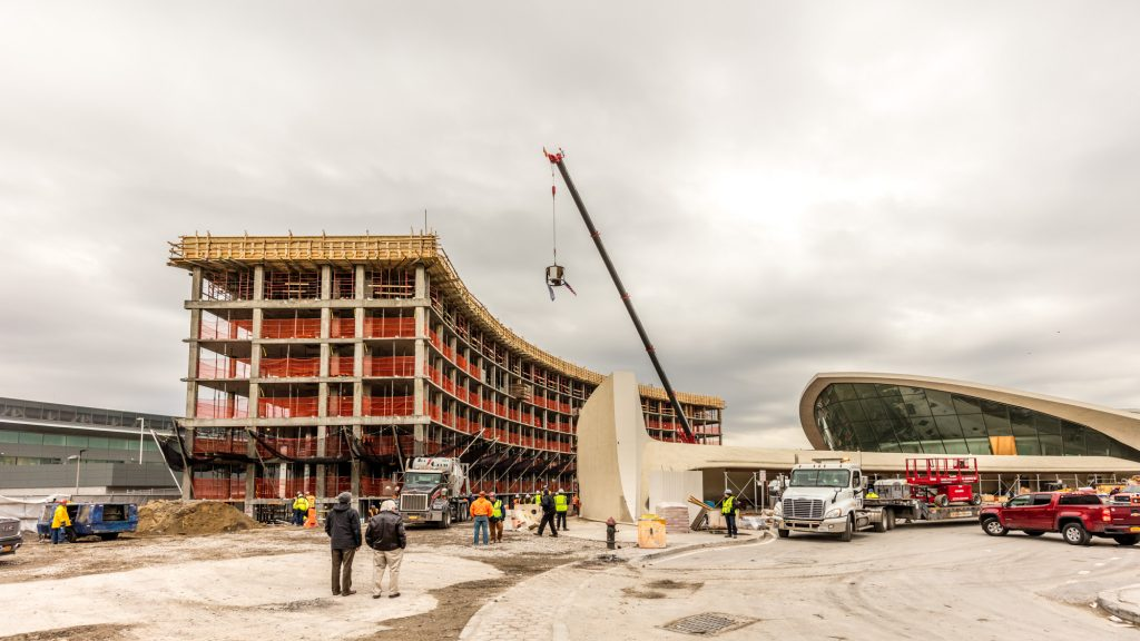 TWA Topping Out--TWA Hotel flag and American flag raised by crane above the north hotel structure (Max Touhey)