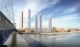 Rendering shows Two Bridges waterfront with several proposed large-scale buildings. Credit: SHoP Architects.