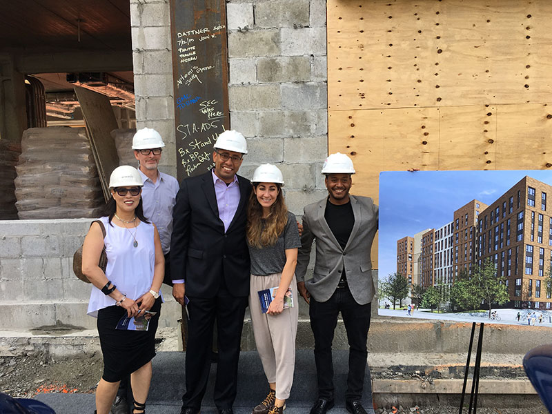 Dattner Architects team photo at 1932 Bryant Avenue. (From left to right: Sally Greene (Owner's Rep for ANYCH); John Woelfling (Principal-in-Charge); Philippe Martelly (Project Manager); Pascale Baladi (designer); Andrew Harris (designer))