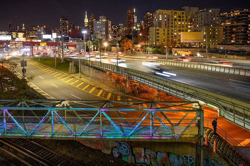 Lighting installation by Chris Jordan seen on the pedestrian bridge (Courtesy of CTC Studio for Related Companies)