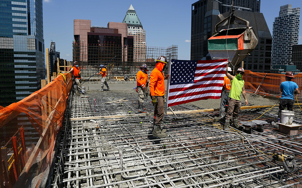Construction Workers Hoisting U.S. Flag atop the new Hard Rock Hotel in Times Square
