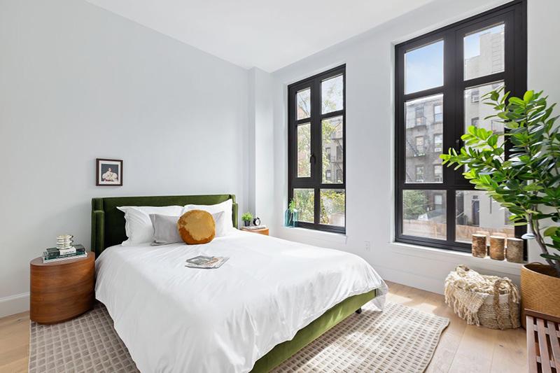 Model bedroom at 552 Prospect Place - CAVU Property Management