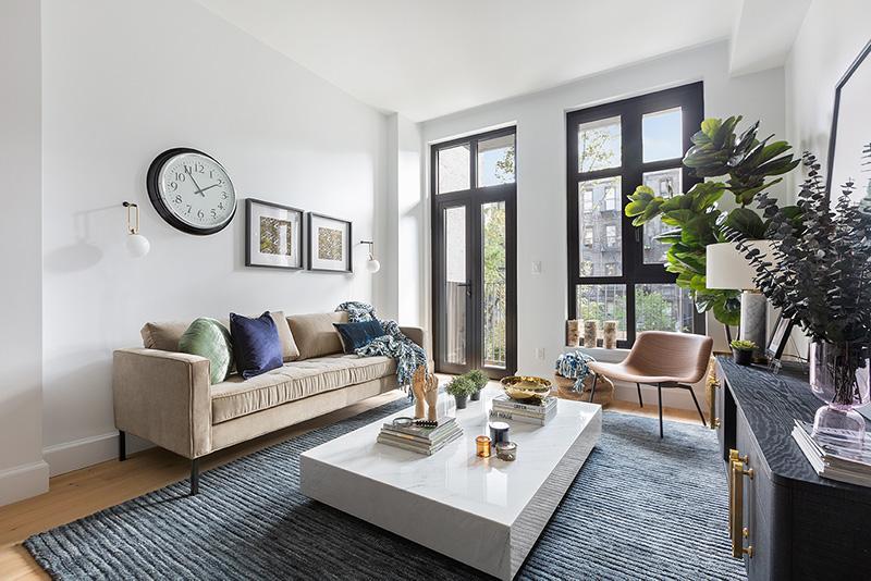 Model living room at 552 Prospect Place - CAVU Property Management