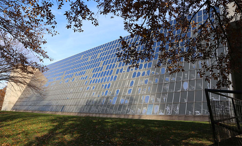 Existing conditions of deteriorated plastic film and corroding curtain wall framing; Rockefeller Wing - Beyer Blinder Belle